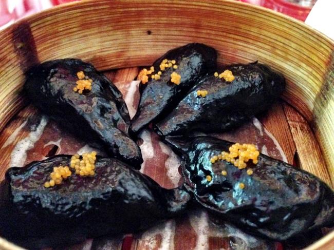 Ravioli ai Nero di Seppia con ripieno di Branzino